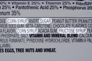 Closeup of ingredients list of granola health bar with forms of sugar highlighted...